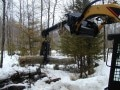 HC6X-A-9, a custom fitted grapple on a skid steer loader